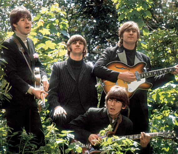 "The Beatles walk and sing as they are filmed during a promotional video for their song ""Rain"", in a garden outside Chiswick House"