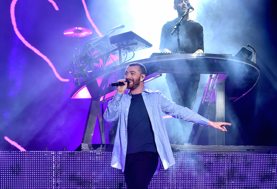 INDIO, CA - APRIL 16: Singer Sam Smith (L) performs with Guy Lawrence (R) of Disclosure during the Disclosure show on day 2 of the 2016 Coachella Valley Music & Arts Festival Weekend 1 at the Empire Polo Club on April 16, 2016 in Indio, California. (Photo by Kevin Winter/Getty Images for Coachella)