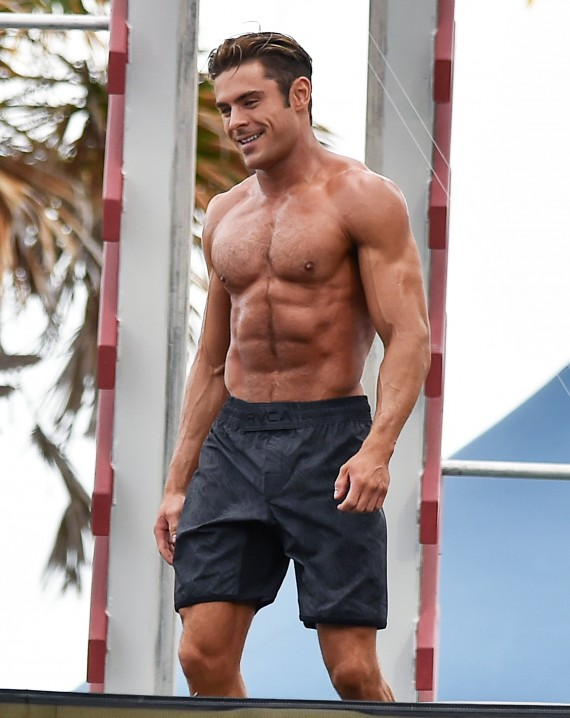 51990672 Actor Zac Efron shows off his toned beach bod while filming a shirtless scene for the upcoming 'Baywatch' film in Miami, Florida on March 8, 2016. FameFlynet, Inc - Beverly Hills, CA, USA - +1 (310) 505-9876